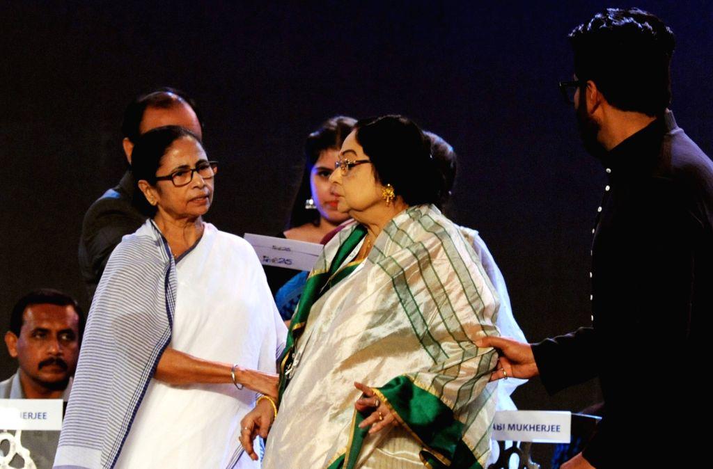 West Bengal Chief Minister Mamata Banerjee with actress Madhabi Mukherjee during the closing ceremony of 25th Kolkata International Film Festival (KIFF) in Kolkata on Nov 15, 2019. - Mamata Banerjee and Madhabi Mukherjee