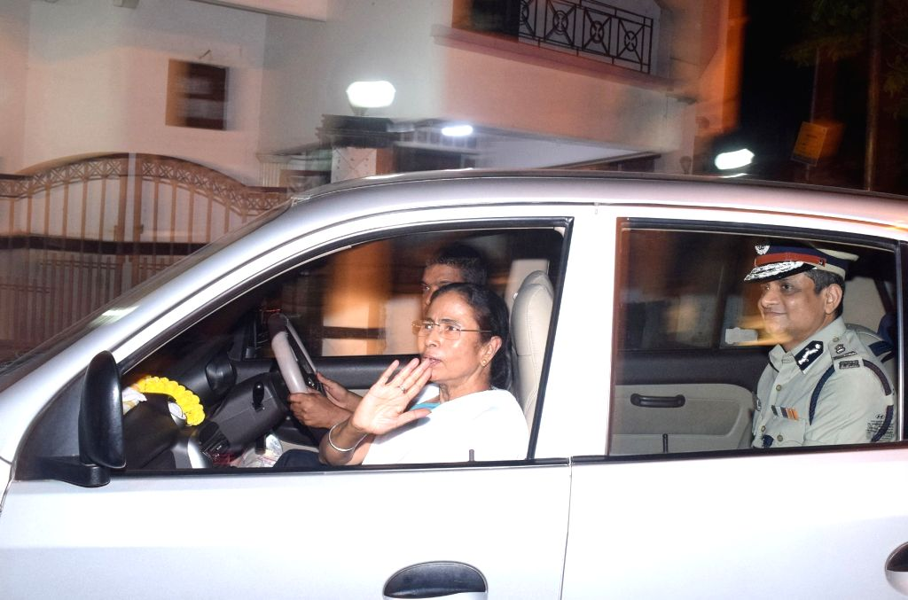 West Bengal Chief Minster Mamata Banerjee leaves after meeting former state Chief Minster Buddhadeb Bhattacharya in Kolkata on April 5, 2018.