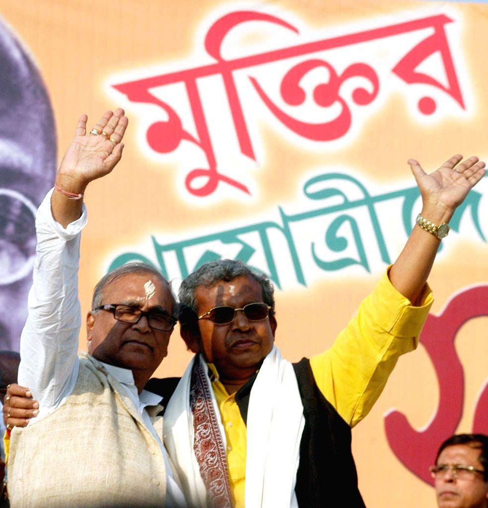 West Bengal Congress President Pradip Bhattcharya and patry leader Manas Bhunia during `Muktir Padayatra` in Kolkata on Dec.13, 2013.