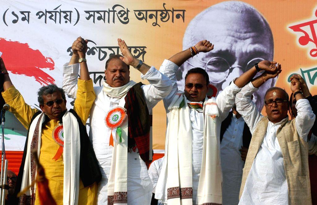West Bengal Congress President Pradip Bhattcharya, Manas Bhunia and other party leaders during `Muktir Padayatra` in Kolkata on Dec.13, 2013.