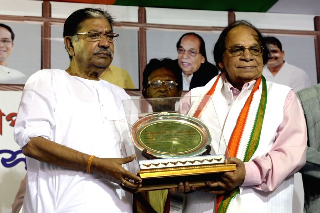West Bengal Congress President Somen Mitra felicitates newly elected party MP from Maldaha Dakshin, Abu Haesem Khan Choudhury at a felicitation programme in Kolkata, on June 8, 2019.