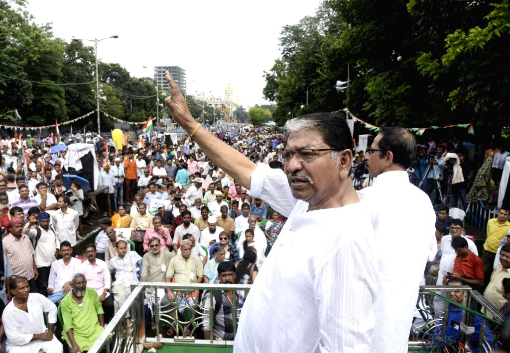 West Bengal Congress president Somen Mitra addresses during a rally organised to protest State and Union Government in Kolkata on Sep 12, 2019.