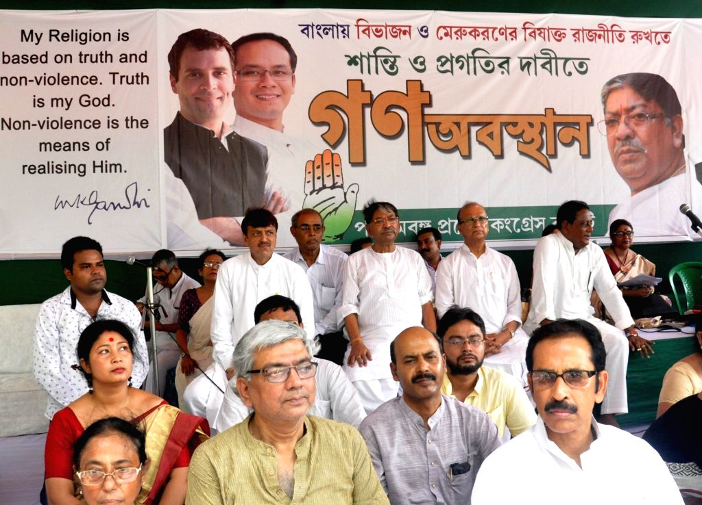West Bengal Congress President Somen Mitra and others during a sit-in demonstration against the state government in Kolkata on June 14, 2019.