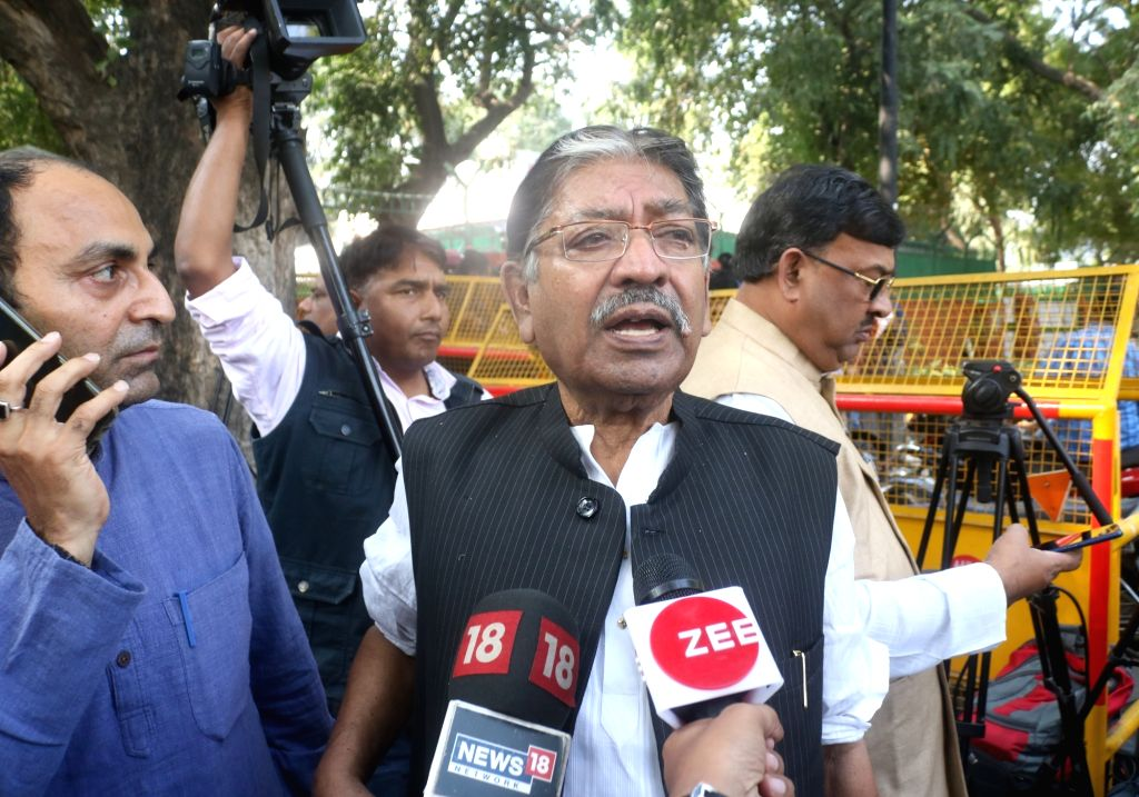 West Bengal Congress President Somendra Nath Mitra talks to the media ahead of attending a party meeting at party president Sonia Gandhi's residence, in New Delhi on Nov 16, 2019. - Somendra Nath Mitra and Sonia Gandhi