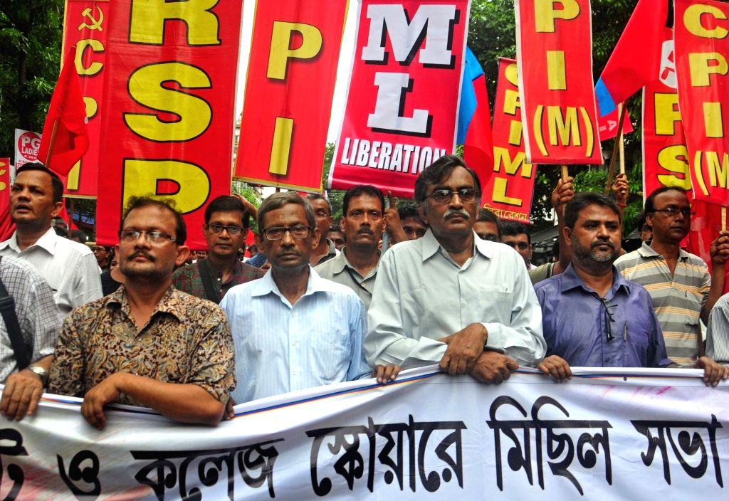 West Bengal CPI-M secretary Surjya Kanta Mishra leads a protest rally against West Bengal Government's decision to impose bar on rally and meeting in College street area in Kolkata on Jul 4, ... - Surjya Kanta Mishra
