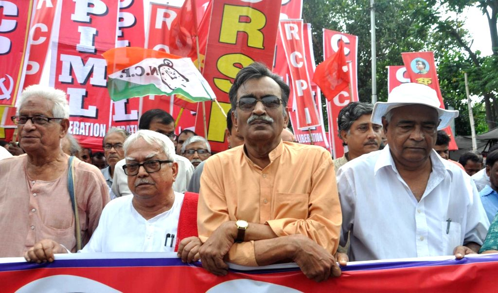 West Bengal CPI(M) secretory Surya Kanta Mishra, Left front Chairman Biman Bose along with other left leaders participate in a Left Front rally in Kolkata on Aug 17, 2017. - Kanta Mishra and Biman Bose