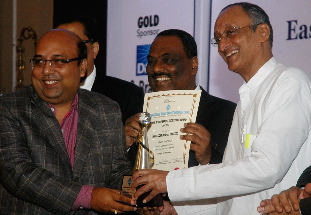 West Bengal Finance and Industry Minister Amit Mitra during Eastern Region Excellence Award distribution ceremony in Kolkata on July 17, 2014. - Amit Mitra
