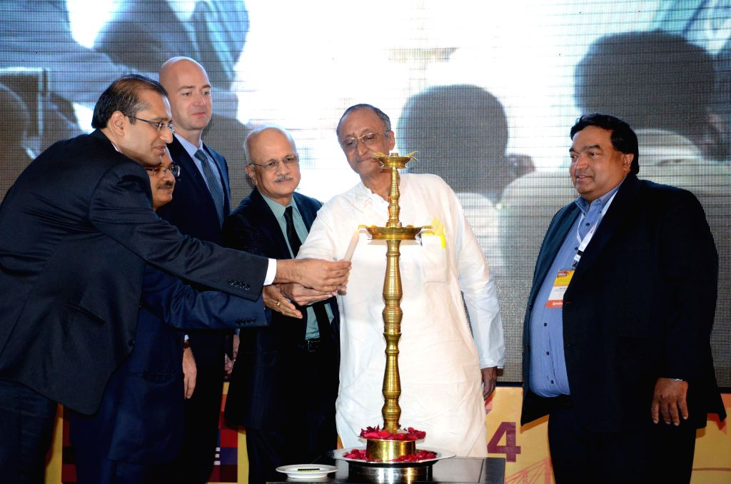 West Bengal Finance and Industry Minister Amit Mitra and NASSCOM President  R Chandrashekhar during inauguration of 'NASSCOM Product Conclave' in Kolkata on July 18, 2014. - Amit Mitra