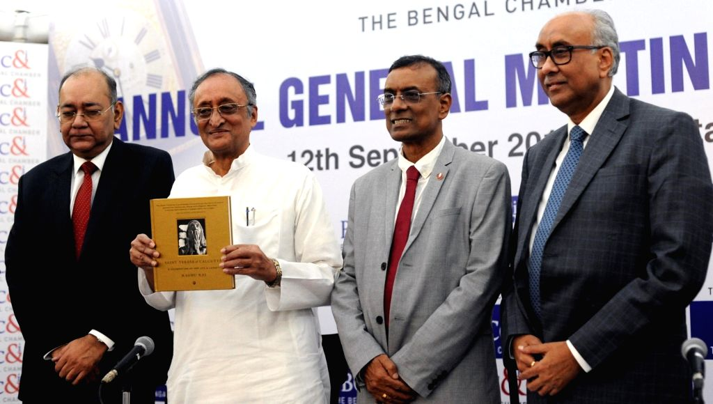 West Bengal Finance minister Amit Mitra, the Bengal Chamber of Commerce and Industry (BCC&I) former President Subhodip Ghosh, BCC&I current President C S Ghosh and Reserve Bank of ... - Amit Mitra, Subhodip Ghosh and C S Ghosh