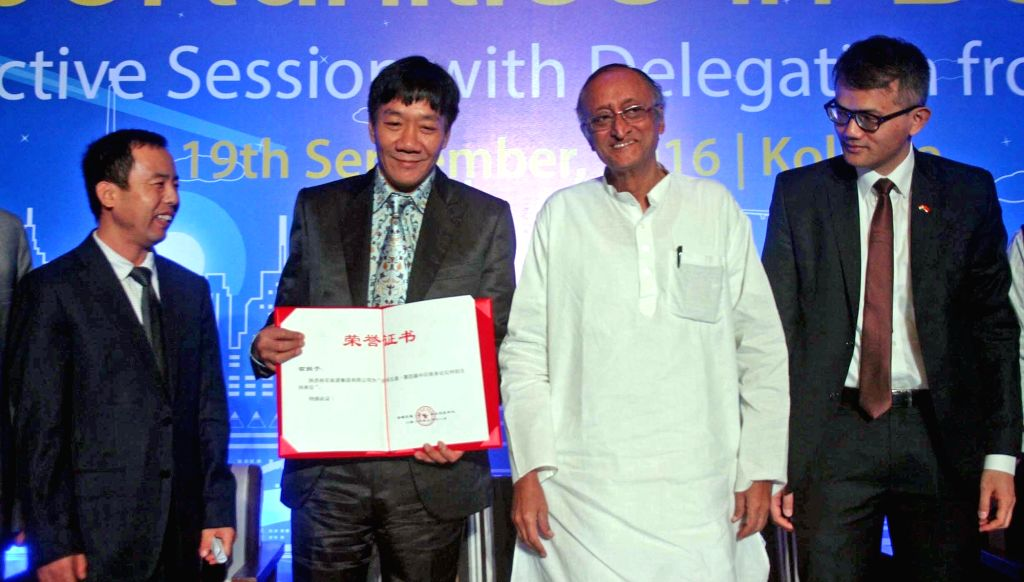 West Bengal Finance Minister Amit Mitra with Chinese delegates during 'Opportunities in Bengal' - an interactive session in Kolkata, on Sept 19, 2016. - Amit Mitra