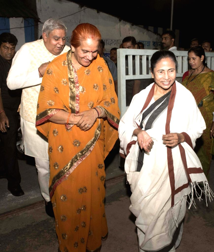 West Bengal Governor Jagdeep Dhankar and his wife Sudesh Dhankhar with Chief Minister Mamata Banerjee during their visit to her residence during Kali Puja celebrations in Kolkata, on Oct 27, ... - Mamata Banerjee
