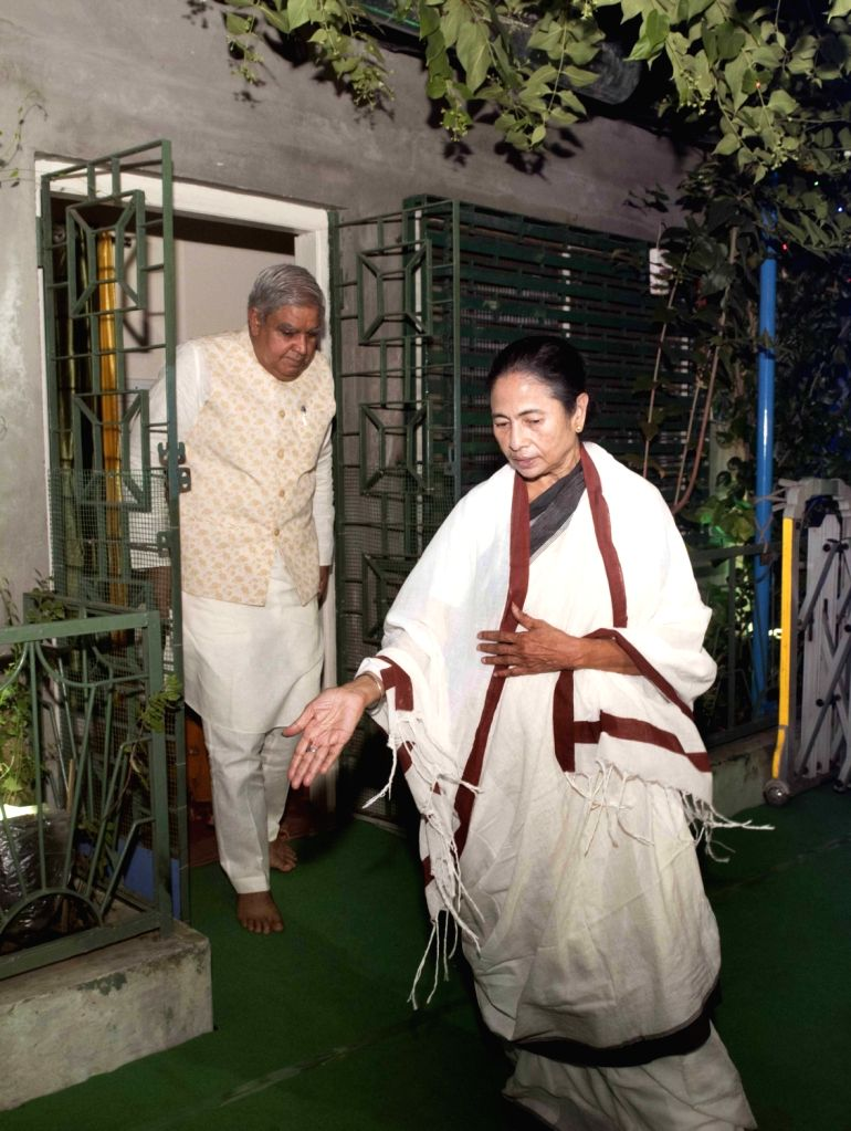 West Bengal Governor Jagdeep Dhankar being received by Chief Minister Mamata Banerjee on his arrival at her residence to participate in Kali Puja celebrations in Kolkata, on Oct 27, 2019. - Mamata Banerjee