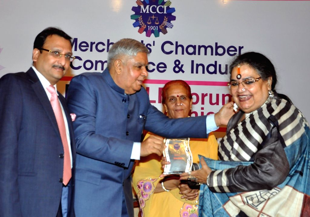 West Bengal Governor Jagdeep Dhankhar felicitates singer Usha Uthup during 'MCCI MLF Forum On Women Achievers' programme in Kolkata on Sep 23, 2019. Also seen West Bengal Governor Jagdeep ...