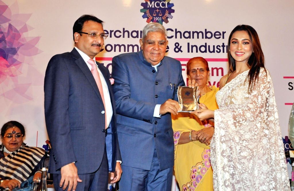 West Bengal Governor Jagdeep Dhankhar felicitates actress Mimi Chakraborty during 'MCCI MLF Forum On Women Achievers' programme in Kolkata on Sep 23, 2019. Also seen West Bengal Governor ... - Mimi Chakraborty