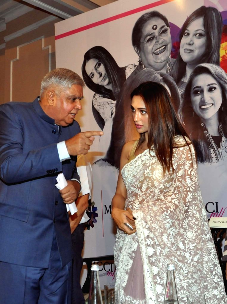West Bengal Governor Jagdeep Dhankhar in a conversation with actress Mimi Chakraborty during 'MCCI MLF Forum On Women Achievers' programme in Kolkata on Sep 23, 2019. - Mimi Chakraborty