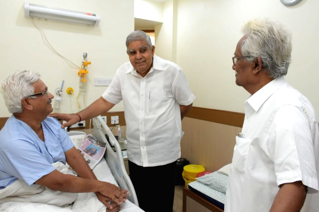 West Bengal Governor Jagdeep Dhankhar meets Jadavpur University Pro-Vice Chancellor Pradip Ghosh, now under treatment at the privately run AMRI Hospital in Kolkata on Sep 21, 2019.