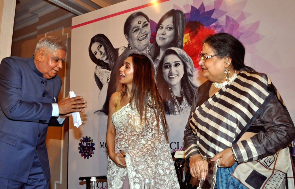 West Bengal Governor Jagdeep Dhankhar with actress Mimi Chakraborty and singer Usha Uthup during 'MCCI MLF Forum On Women Achievers' programme in Kolkata on Sep 23, 2019. - Mimi Chakraborty