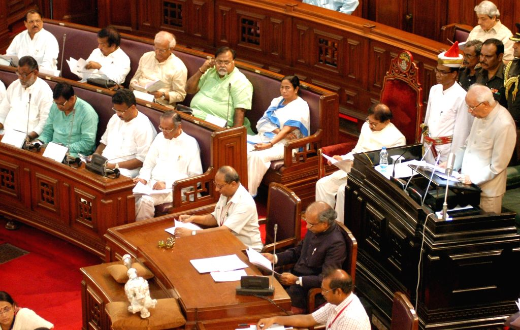 West Bengal Governor Keshari Nath Tripathi addresses during the budget session at West Bengal Assembly in Kolkata on June 17, 2016. Also seen West Bengal Chief Minister Mamata Banerjee and ... - Mamata Banerjee, Keshari Nath Tripathi and Partha Chatterjee