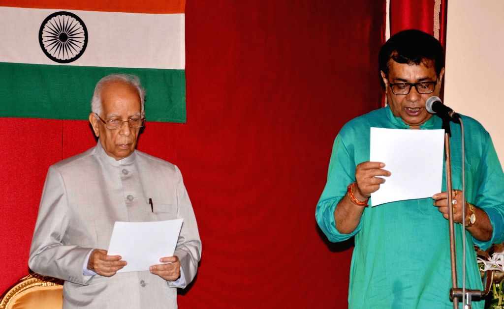 West Bengal Governor Keshari Nath Tripathi administers oath of office and secrecy to Ujjwal Biswas during at Raj Bhavan in Kolkata on May 15, 2017. - Keshari Nath Tripathi