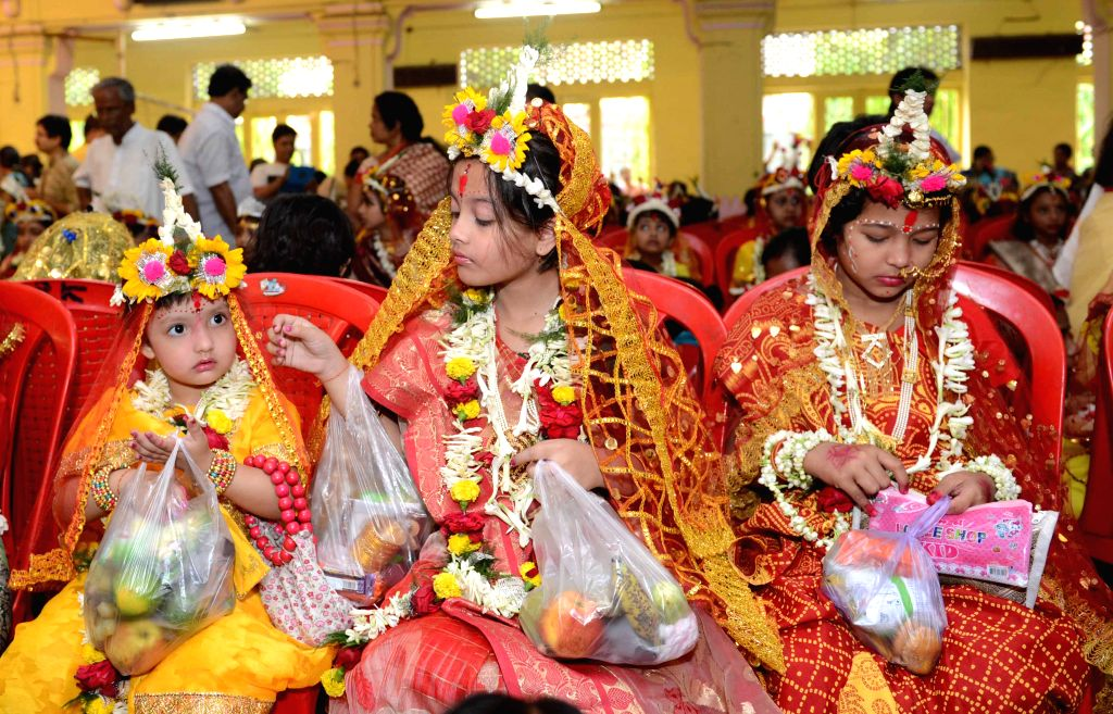 West Bengal: Hindu devotees worship young girls during Kumari Puja at Adyapith, North 24 Parganas in West Bengal on March 28, 2015.