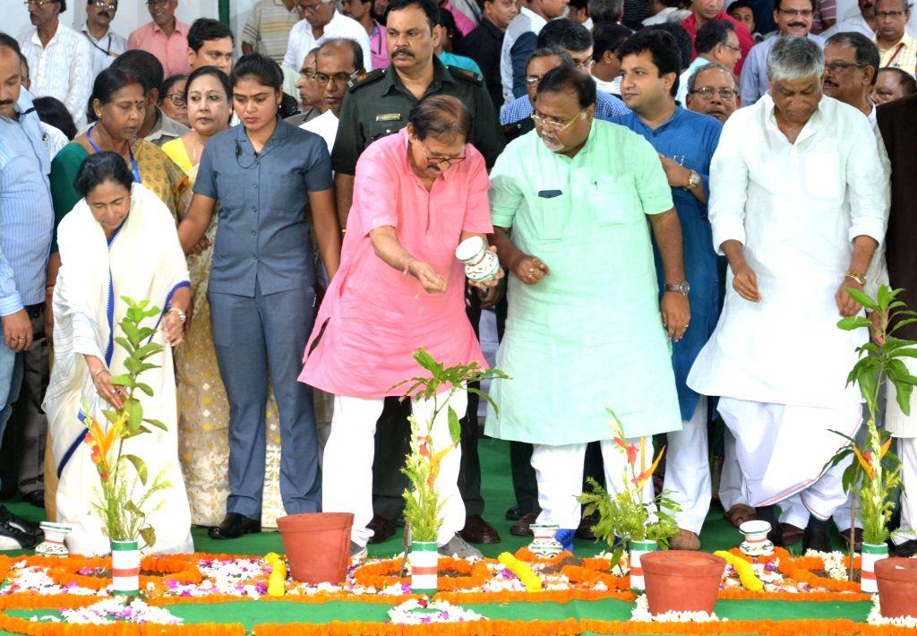 "West Bengal Legislative Assembly Speaker Biman Banerjee, Chief Minister Mamata Banerjee along with other ministers celebrate ""Van Mahotsav""  at State Assembly in Kolkata on July ... - Biman Banerjee and Mamata Banerjee"