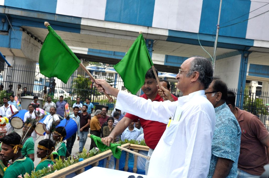 West Bengal Minister Amit Mitra and Partha Chatterjee flag off a tableau of achievement of State Government in several sectors, in Kolkata on May 20, 2017. - Amit Mitra and Partha Chatterjee