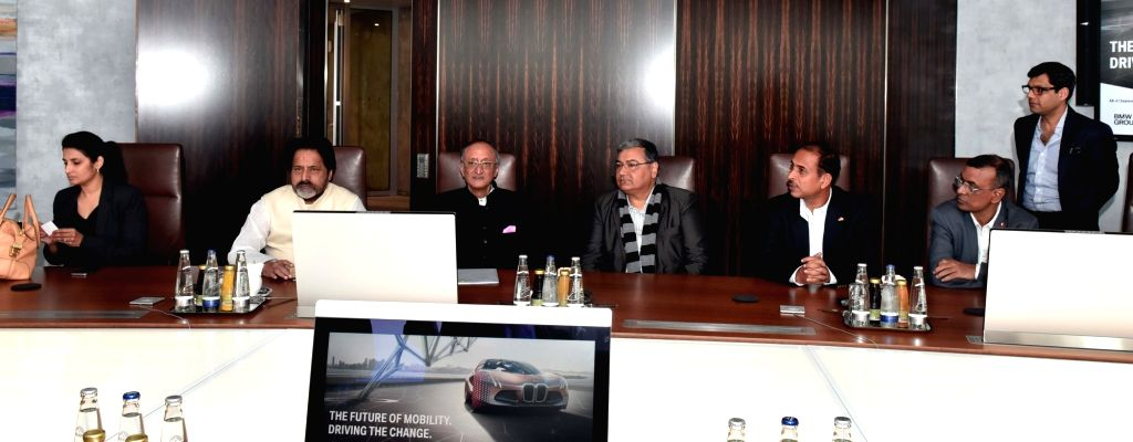 West Bengal Minister Amit Mitra and Trinamool Congress leader Sudip Bandyopadhyay with BMW officials in Munich, Germany on Sept 6, 2016. - Amit Mitra