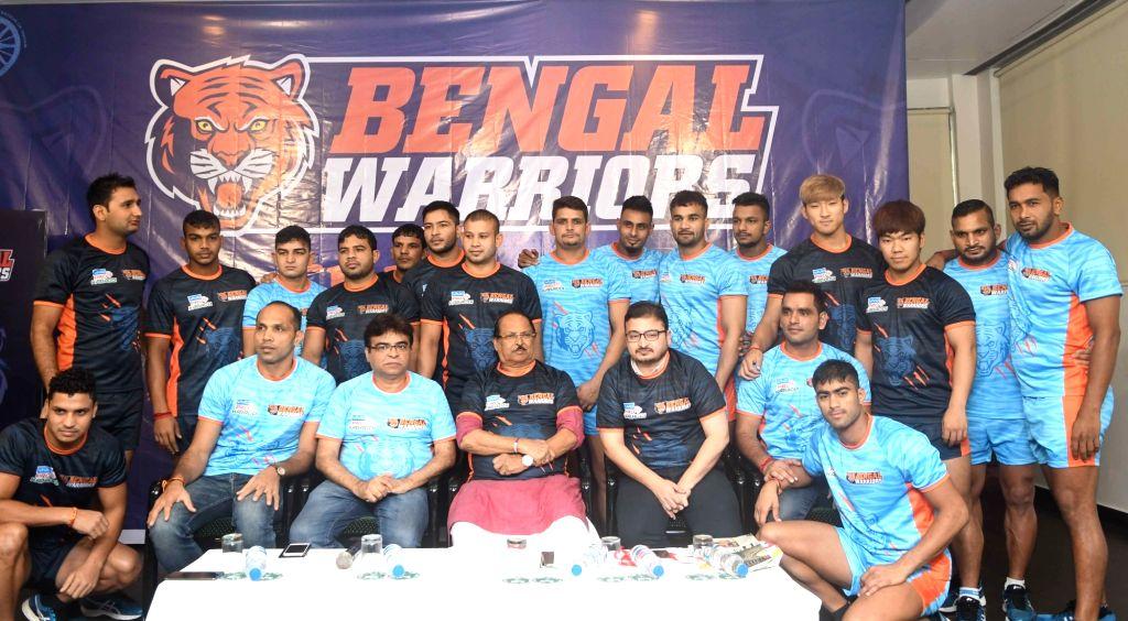 West Bengal Minister for Public Health Engineering Subrata Mukherjee, Pro Kabaddi team Bengal Warriors CEO Sandip Tarkas and coach KK Jagadeesha Kumble with players during a press conference ...