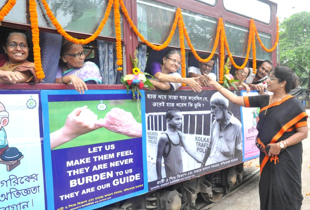 West Bengal Minister for Women and Child Development Shashi Panja interacts with elderly women during a tram ride organised for senior citizens on the occasion of World Elder Abuse ...