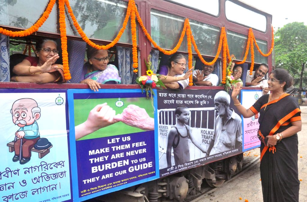West Bengal Minister for Women and Child Development Shashi Panja interacts with elderly women during a tram ride organised for senior citizens on the occasion of World Elder Abuse Awareness ...