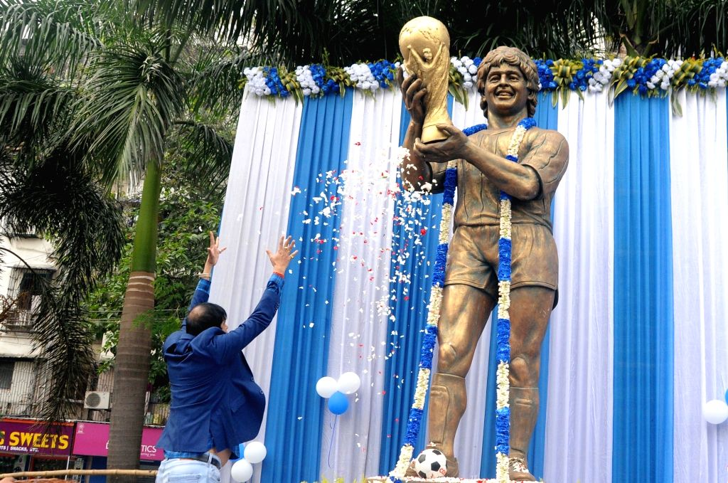 West Bengal Minister Sujit Bose pays tributes to legendary Argentinian footballer Diego Maradona, in Kolkata on Nov 26, 2020. The footballer passed away on Wednesday evening after suffering ... - Sujit Bose