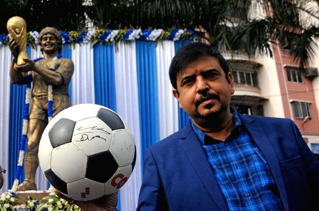 West Bengal Minister Sujit Bose showing the signature of legendary Argentinian footballer Diego Maradona, in Kolkata on Nov 26, 2020. The footballer passed away on Wednesday evening after ... - Sujit Bose