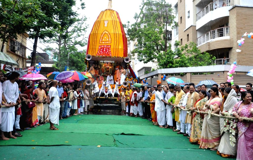 West Bengal Ministers Subrata Mukherjee and Sovan Chatterjee during a rath yatra organised by ISKCON in Kolkata, on June 25, 2017. - Subrata Mukherjee and Sovan Chatterjee
