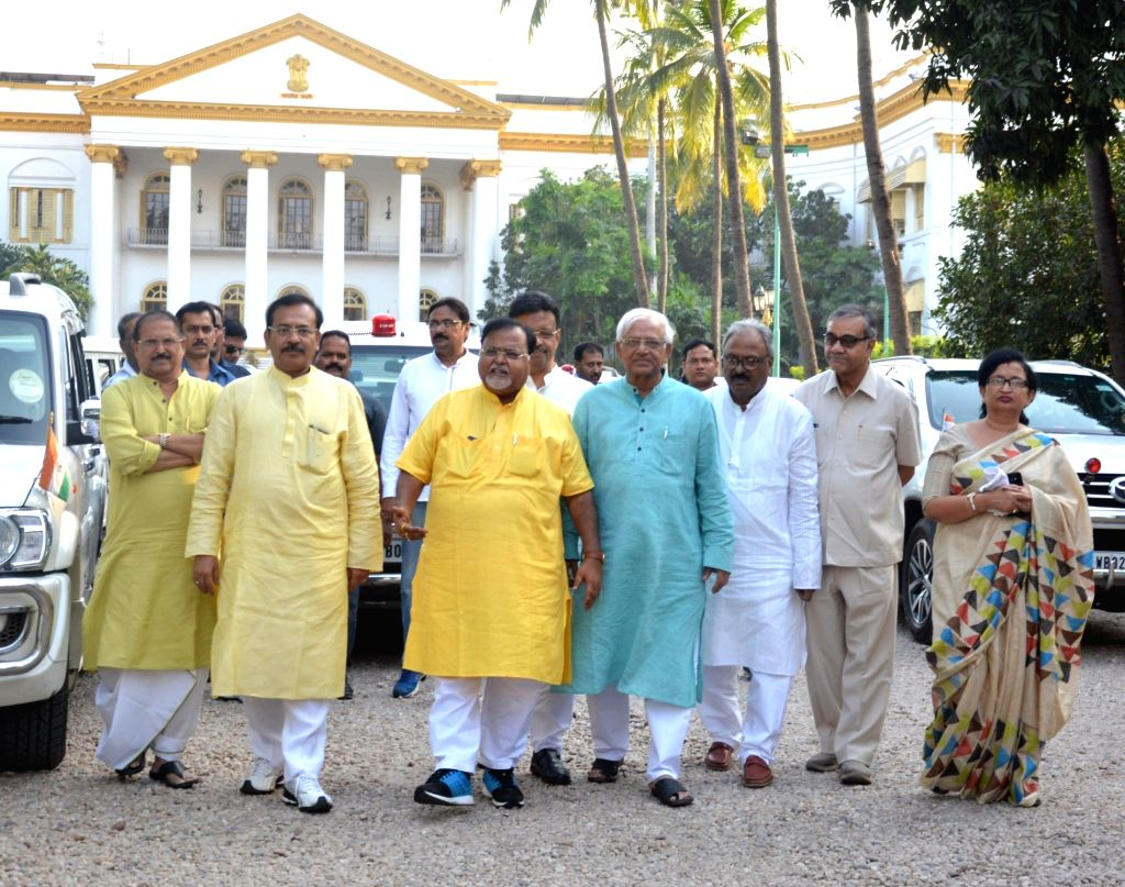 West Bengal Ministers Subrata Mukherjee, Arup Biswas, Partha Chatterjee, Fihad Hakim and Sovandeb Chatterjee come out after meeting the state's Governor Keshri Nath Tripathi ahead of ... - Subrata Mukherjee, Arup Biswas, Partha Chatterjee, Fihad Hakim, Sovandeb Chatterjee and Keshri Nath Tripathi