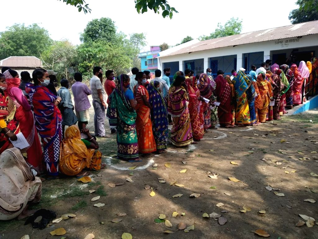 West Bengal: People cast their vote during 1st phase of West Bengal Assembly Election at West Midnapore in West Bengal on Saturday 27th March, 2021.