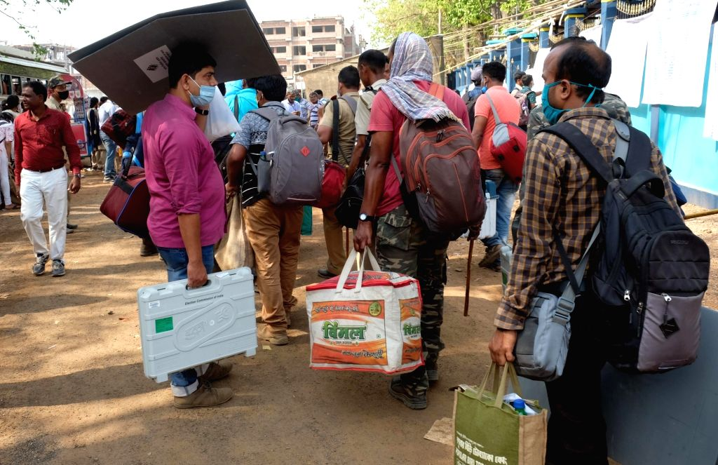 West Bengal: Poll workers being disbursed on the eve of the first phase of Assembly Election for the different polling stations at Jhargram Women's College ground on Friday 26th March 2021.