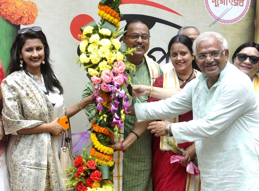 """West Bengal Power Minister Sovandeb Chatterjee, actress Rachana Banerjee and others participate in """"Khunti Puja"""" at Ballygunge Cultural Association ahead of Durga Puja in Kolkata ... - Sovandeb Chatterjee and Rachana Banerjee"""
