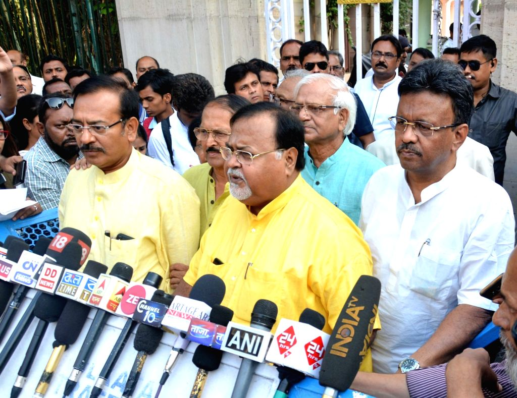 West Bengal's Parliamentary Affairs Minister Partha Chatterjee along with other cabinet ministers, talks to the press after meeting the state's Governor Keshri Nath Tripathi ahead of ... - Partha Chatterjee and Keshri Nath Tripathi