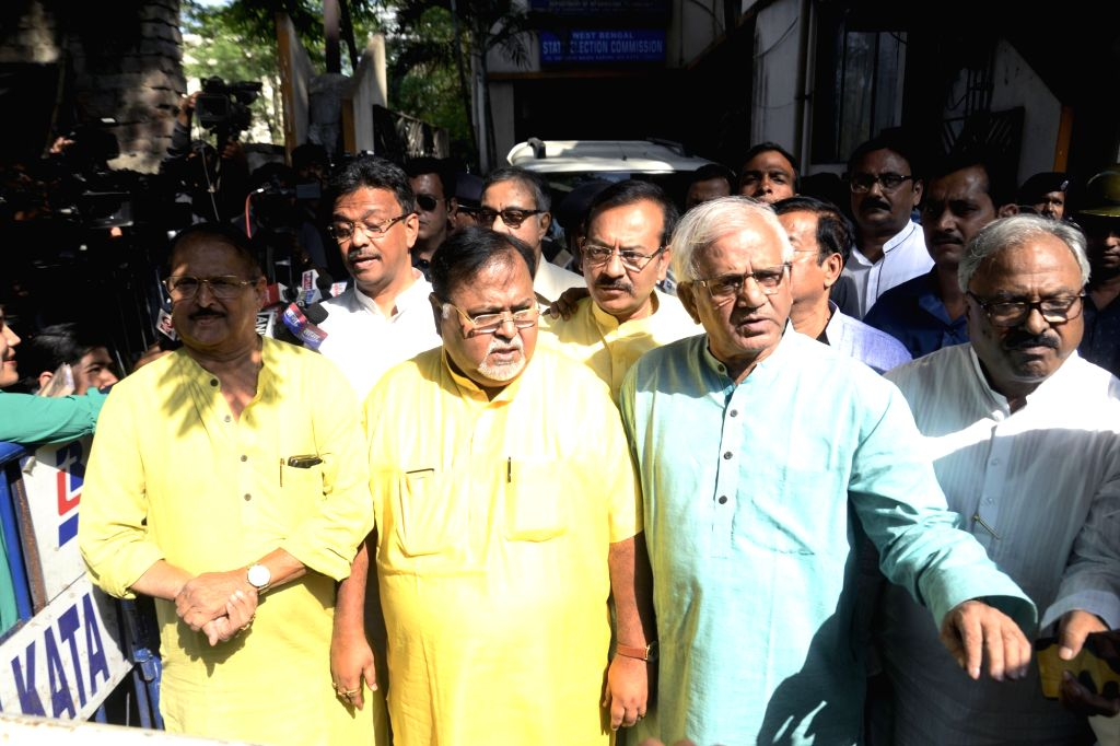 West Bengal's Parliamentary Affairs Minister Partha Chatterjee and other leaders of Trinamool Congress (TMC) come out after meeting State Election Commissioner A K Singh ahead of Panchayat ... - Partha Chatterjee
