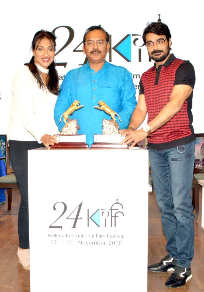 West Bengal's PWD Minister Arup Biswas and actors Rituparna Sengupta and Prasenjit Chatterjee at a press conference regarding the upcoming 24th Kolkata International Film Festival, on Nov 3, ... - Arup Biswas, Rituparna Sengupta and Prasenjit Chatterjee