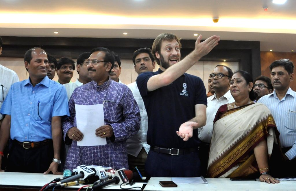 West Bengal Sports and Youth Service Minister Arup Biswas hands over the facilities of Salt Lake Stadium to FIFA U-17 World Cup tournament director Javier Ceppi in Kolkata on Sep 10, 2017. - Arup Biswas