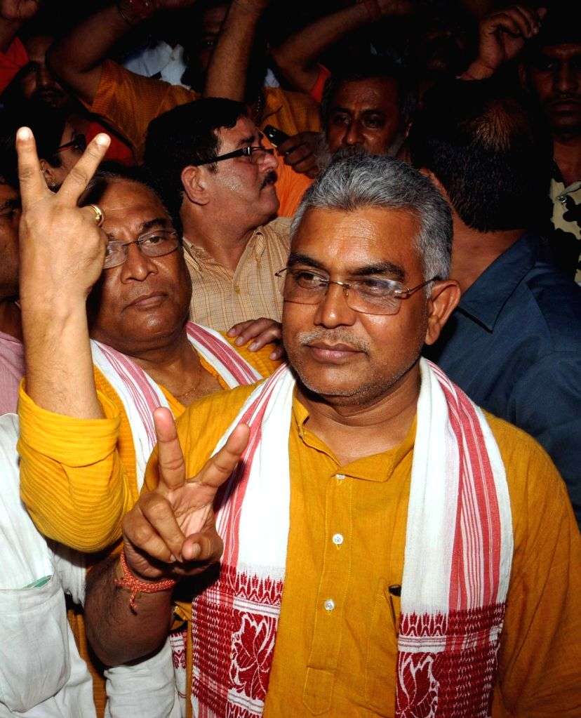 West Bengal State BJP Chief Dilip Ghosh being taken to be produced at a Kolkata court on May 26, 2017. - Dilip Ghosh