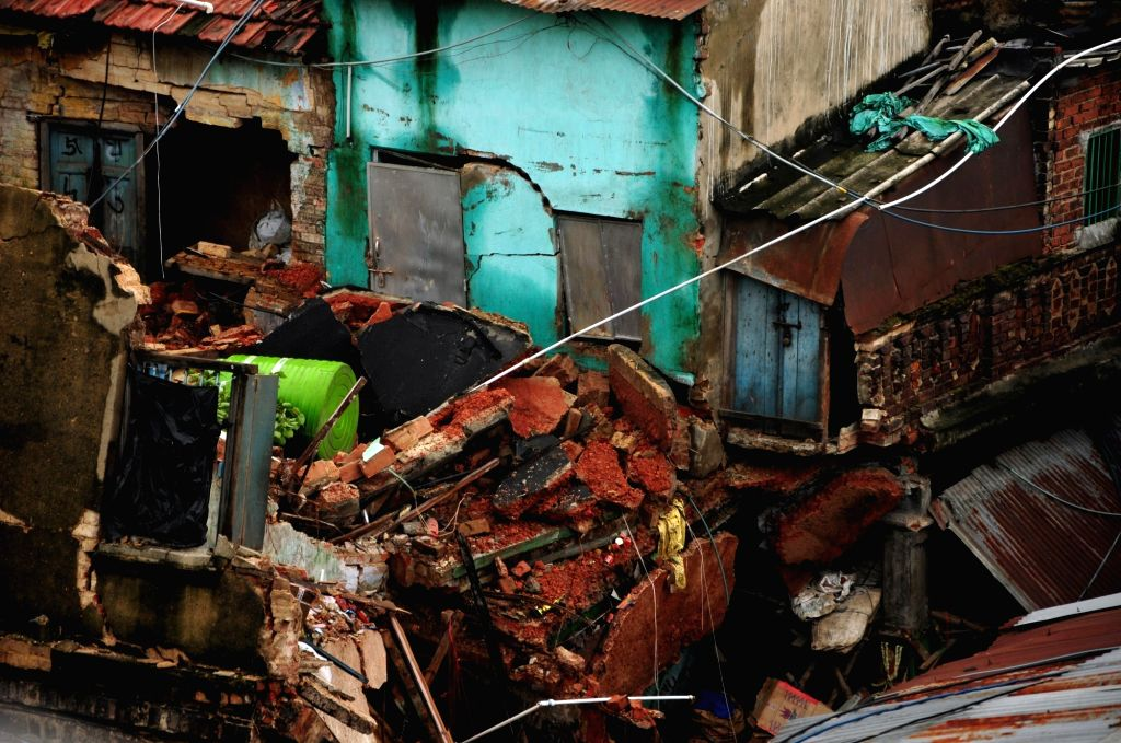 West Bengal State Disaster Management personnel during rescue operations at the site where an old two-storey residential building near Sealdah's Baithakkhana Bazar area collapsed following ...