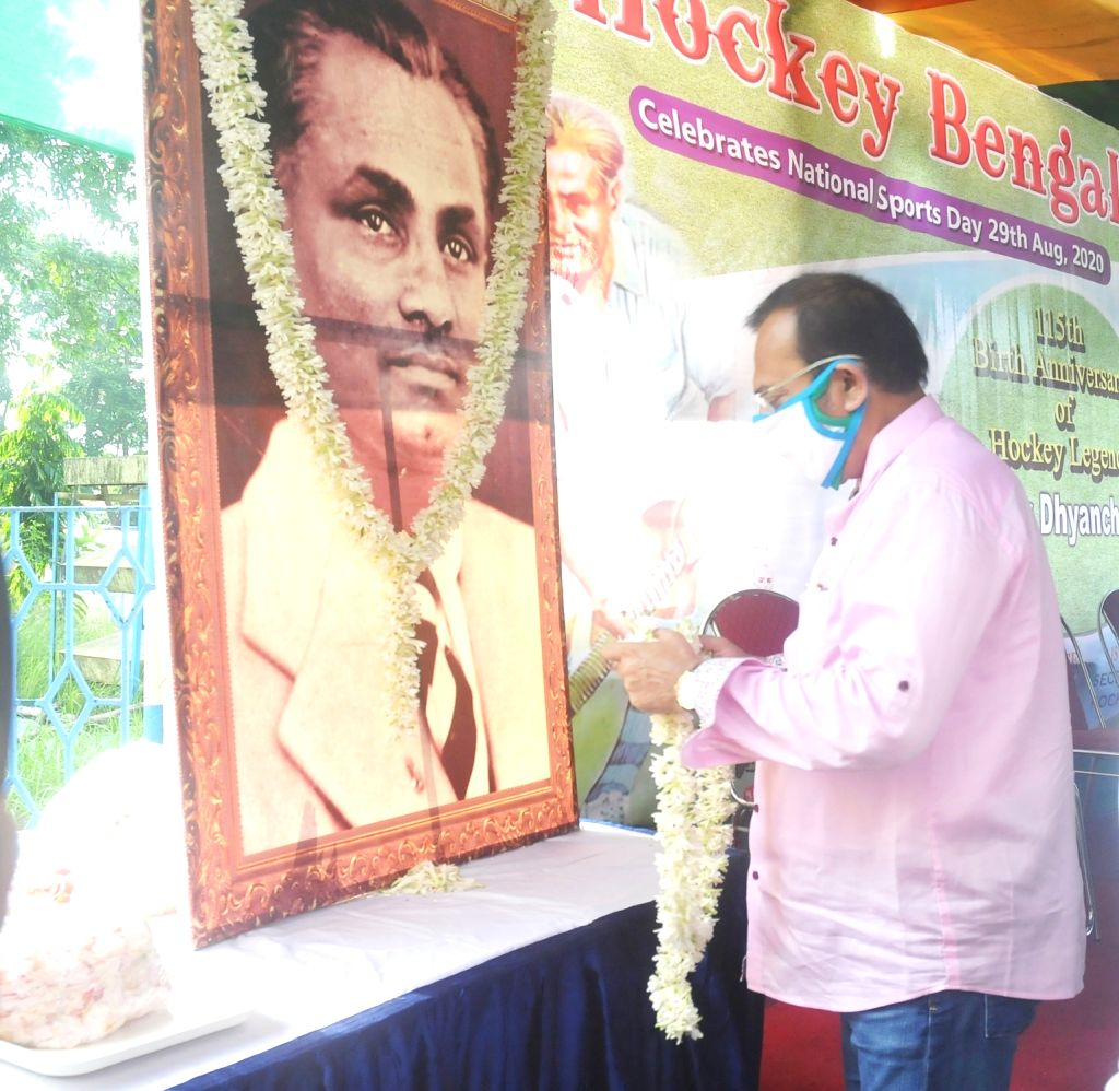 West Bengal State Sports Minister Aroop Biswas pays tribute to Indian hockey legend Dhyan Chand on his 115th Birth Anniversary during National Sports Day in Kolkata August 29, 2020. - Aroop Biswas
