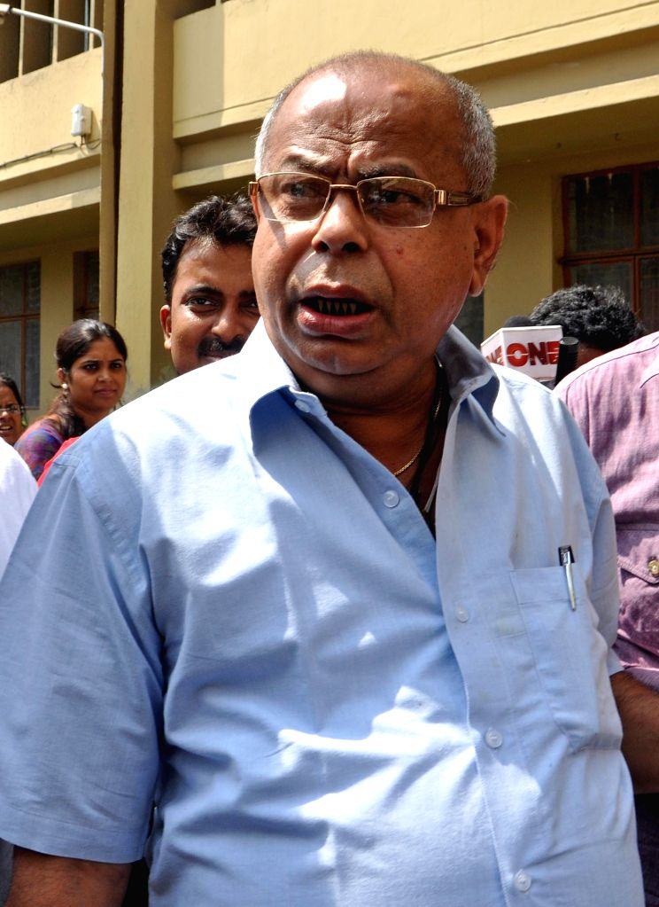 West Bengal Textiles minister Shyamapada Mukherjee arrives to appear before the Enforcement Directorate in connection with the multi-crore-rupee Saradha chit fund scam in Kolkata on Aug 18, 2014.