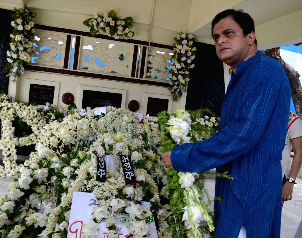 West Bengal Tourism Minister Bratya Basu pay tribute to Rabindranath Tagore on his death anniversary in Kolkata, on Aug 8, 2015.