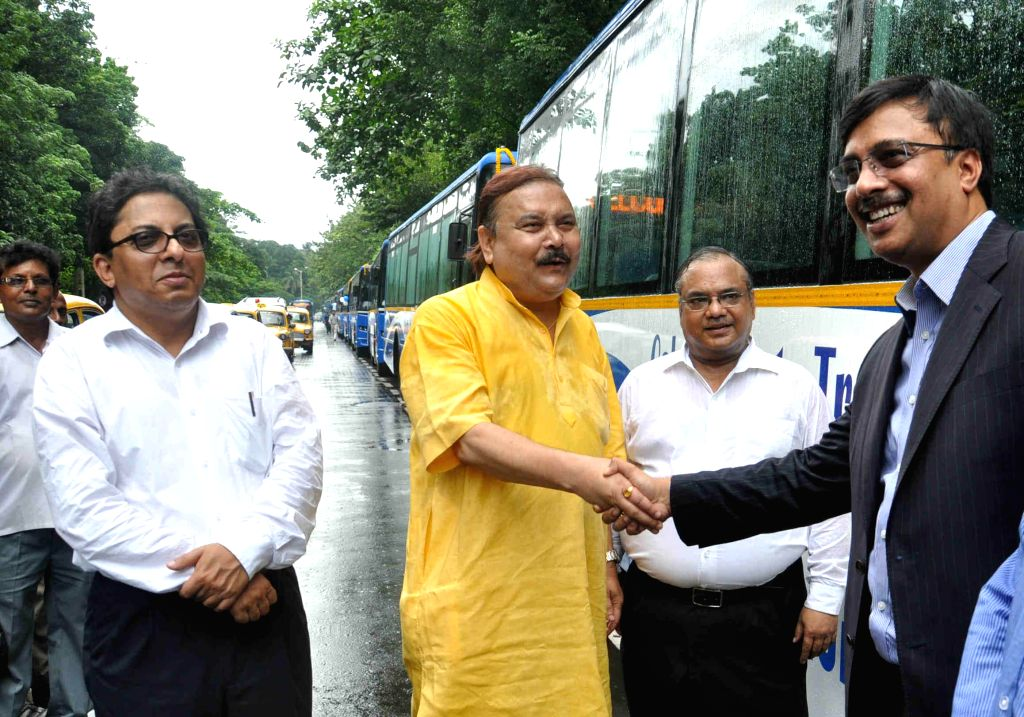 West Bengal Transport Minister Madan Mitra during a programme organised to launch `Jan Bus` in Kolkata on July 30, 2014. - Madan Mitra