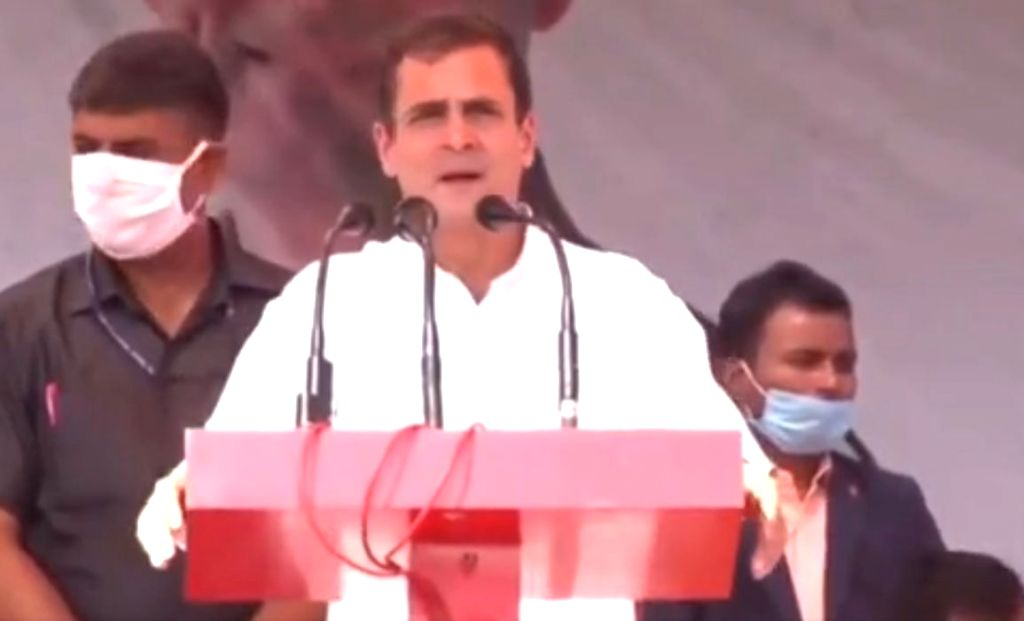 West Champaran: Congress leader Rahul Gandhi addresses a public rally ahead of the remaining two phases of the Bihar Assembly polls, in West Champaran on Oct 28, 2020. - Rahul Gandhi