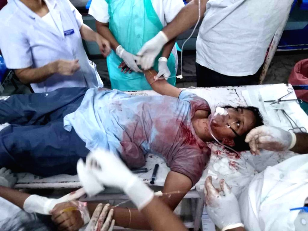West Godavari: A woman receives treatment at a hospital after being attacked with a knife by a man for rejecting his love, in Kavitam village of Poduru mandal of Andhra Pradesh's West Godavari ...