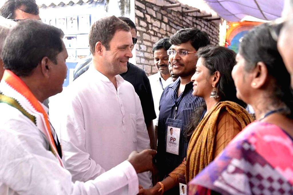 West Godavari: Congress president Rahul Gandhi meets the residents of Pedapadu Village, in Andhra Pradesh's West Godavari district on Sept 18, 2018. - Rahul Gandhi